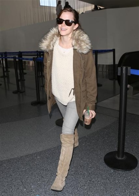 a white oversized sweater, grey skinnies, tan tall boots, a brown parka with faux fur for a cold winter
