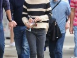 a striped black and white sweater, black skinnies, black boots for a comfy fall outfit