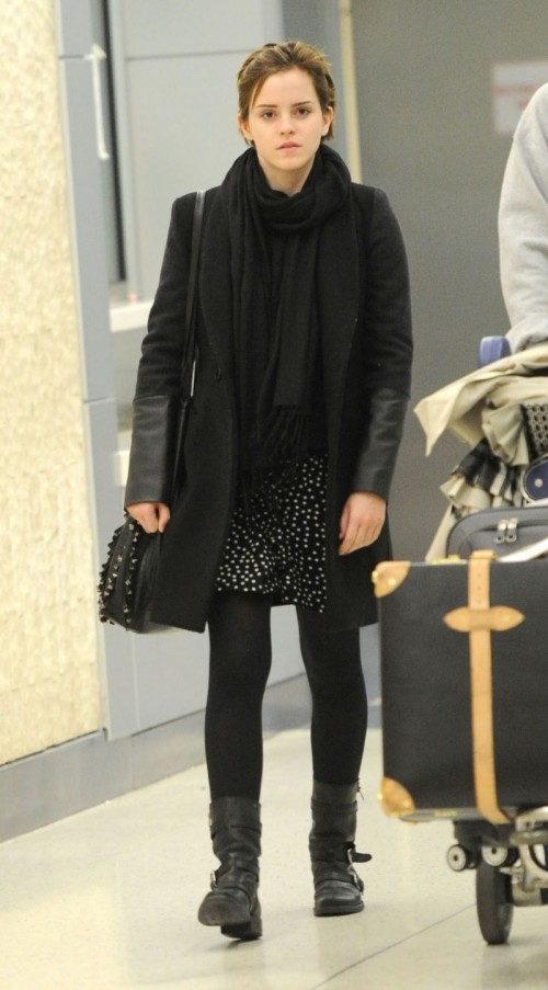 a black and white polka dot mini dress, a black scarf, boots, a short coat and an embellished bag