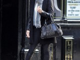 black leather pants, a black coat, a striped scarf, brown booties and a black embellished bag