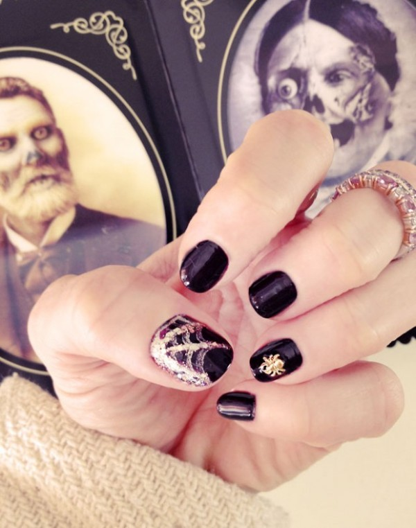 Picture Of festive and glam diy halloween manicure  1