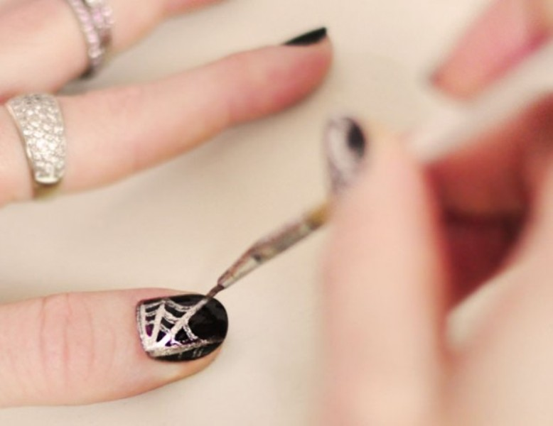 Picture Of festive and glam diy halloween manicure  10