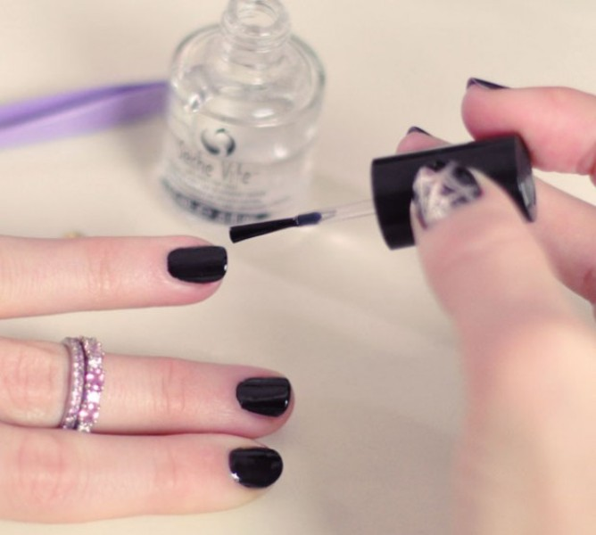 Picture Of festive and glam diy halloween manicure  4