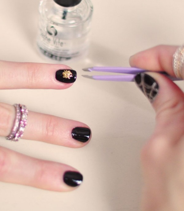 Picture Of festive and glam diy halloween manicure  6