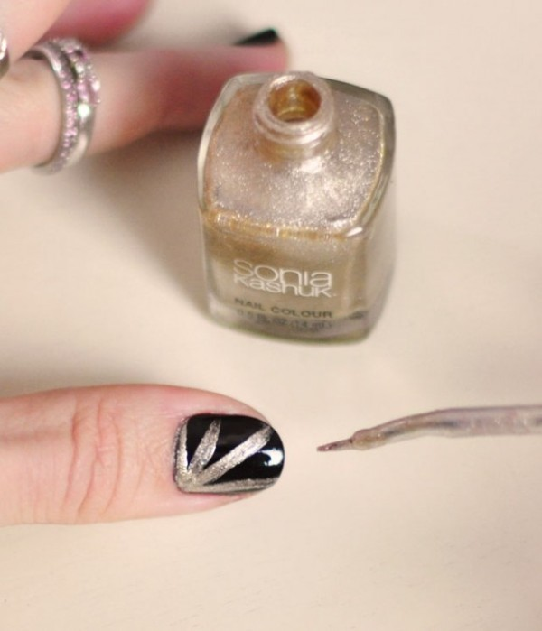 Picture Of festive and glam diy halloween manicure  8