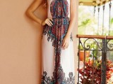 a boho printed maxi dress with spaghetti straps looks bold, fun and cool and brings a boho touch to your look