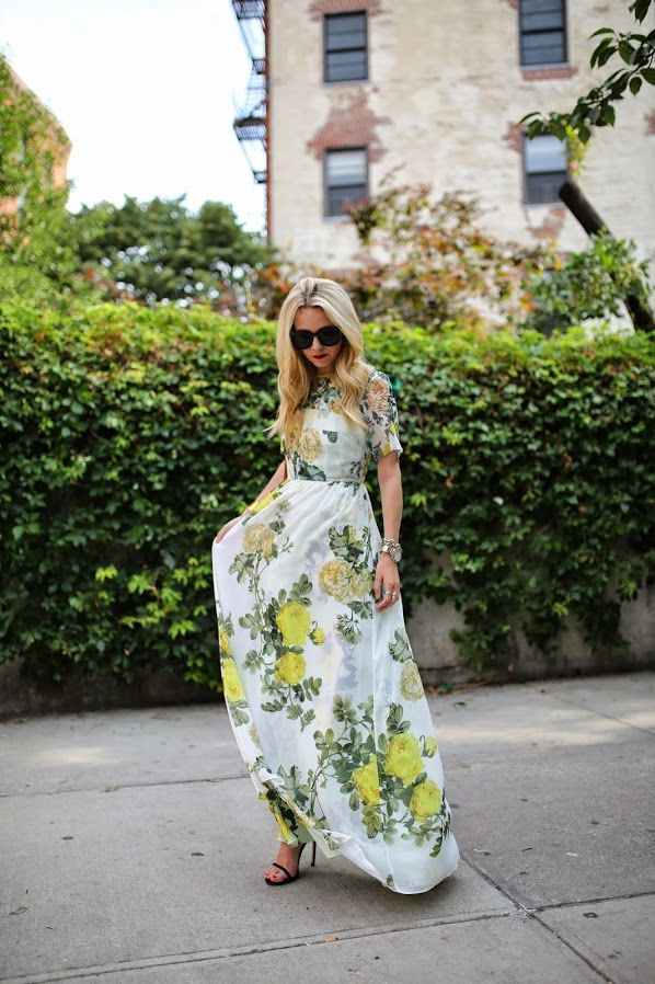a white realistic floral pattern maxi dress and black minimalist heels for a special occasion or party