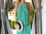 a grene and white printed maxi dress with a halter neckline worn over a swimsuit is a perfect option for a holiday