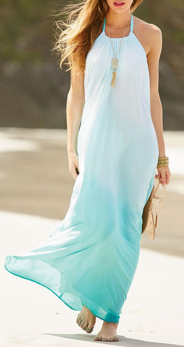 an ombre aqua colored halter neckline beach maxi dress and a statement boho necklace for going to the beach