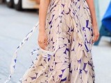 a blush and purple floral print A-line maxi dress with a high neckline and short sleeves plus purple flats for a special occasion