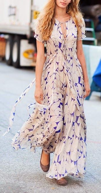 a blush and purple floral print A line maxi dress with a high neckline and short sleeves plus purple flats for a special occasion