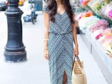a relaxed striped maxi dress with a V-neckline, short sleeves, a front slit, a woven bag and sandals for summer