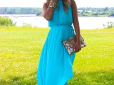 a turquoise halter neckline maxi dress, nude heels and shiny clutch for a special occasion