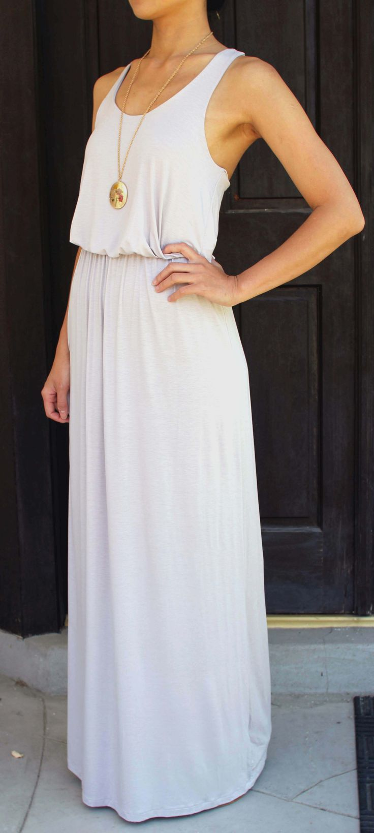 a white maxi dress with thick straps and a scoop neckline plus a statement necklace is a cool idea for every day