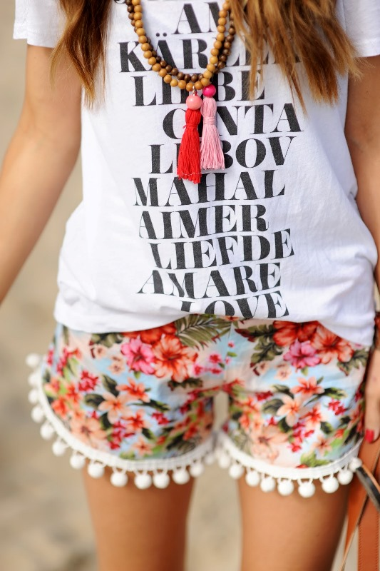 Picture Of funny and comfy diy pom pom beach shorts  1