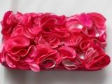 bright fabric flower clutch
