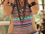 a bright boho striped one piece swimsuit with cutout sides and layered necklaces for a boho-loving girl