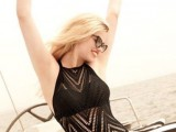 a black boho lace one piece swimsuit with a halter neckline and geometric patterns