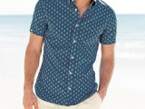 a navy printed short-sleeve shirt and tan shorts are all you need for a relaxed beach holiday