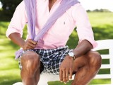 a pink shirt, plaid shorts, two tone shoes and a lavender sweater in case it gets a bit colder