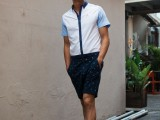 a white and blue shirt with a navy edge, navy shorts, black slippers will make you look cool and feel comfortable