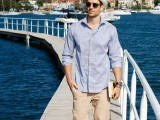 a bleu striped long sleeve shirt, tan pants, a white hat for a cool seaside look in summer