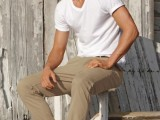 a white tee, tan pants, a hat and navy espadrilles are a classic outfit for having a holiday at the seaside