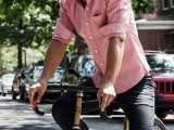 a pink linen shirt, black pants and burgundy trainers for a bright summer or holiday look