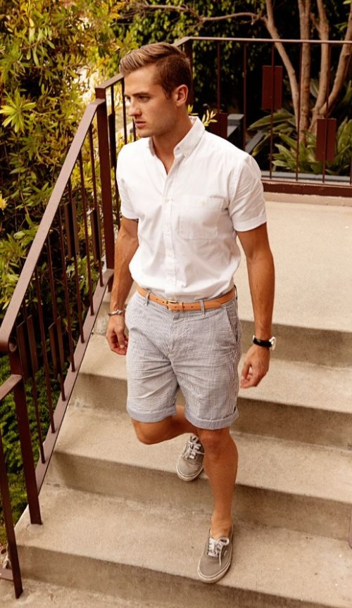 a white short sleeve shirt, striped shorts, grey sneakers for a relaxed and casual holiday