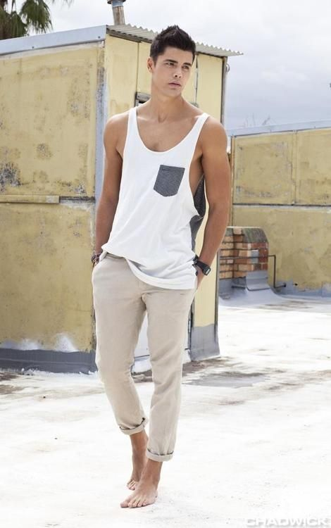 an oversized white tank top and tan pants for a hot day - it's a very comfy outfit to rock