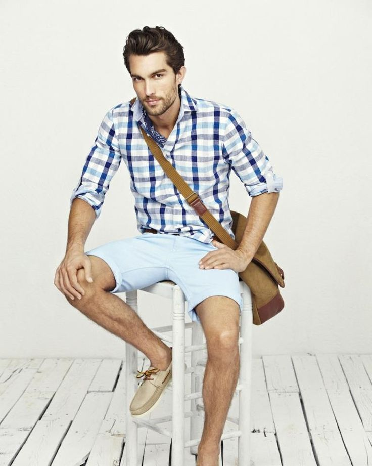 a blue plaid shirt, light blue shorts, tan moccasins and a crossbody bag is a simple and relaxed look