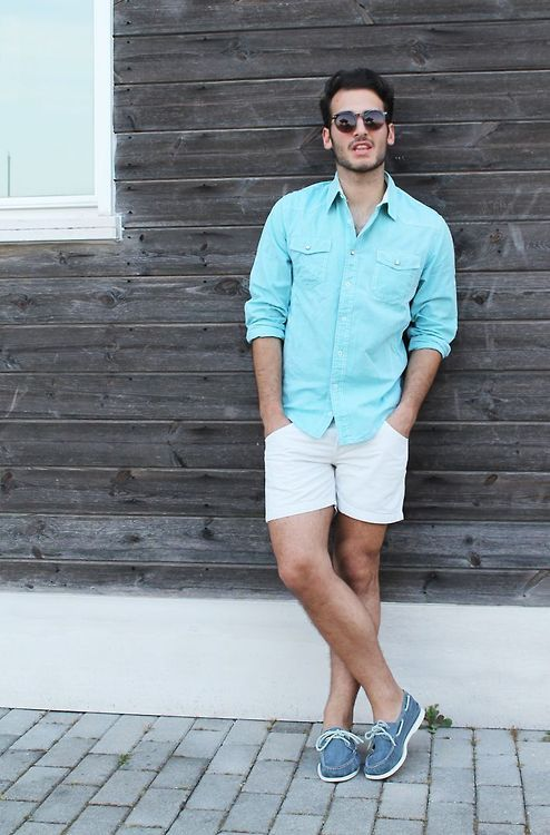 a chambray shirt, white shorts, blue moccasins for a relaxed seaside look