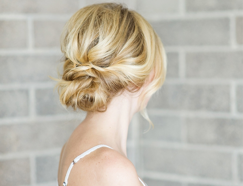 Picture Of romantic and easy diy low bun with crisscross  1