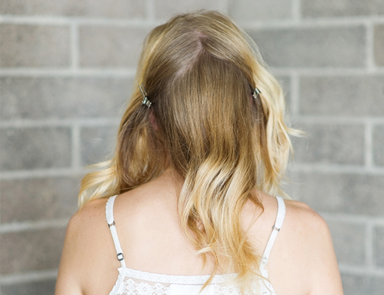Picture Of romantic and easy diy low bun with crisscross  2
