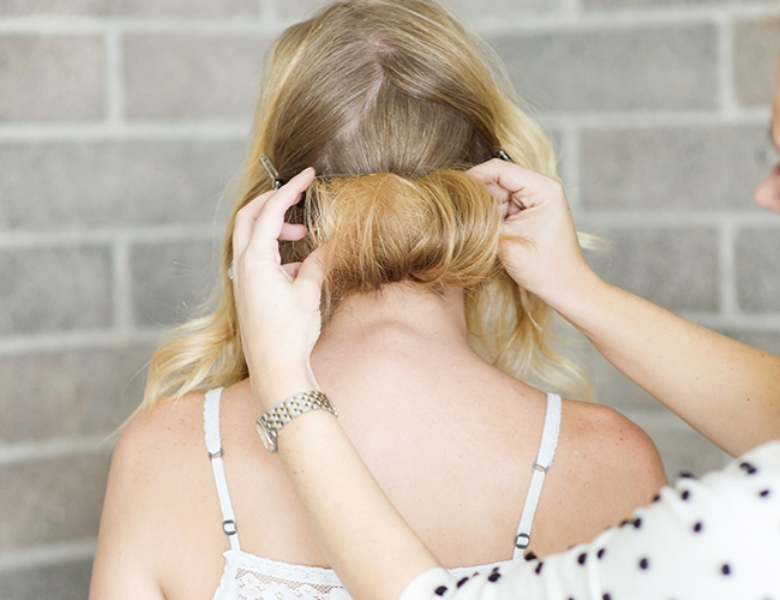 Picture Of romantic and easy diy low bun with crisscross  5