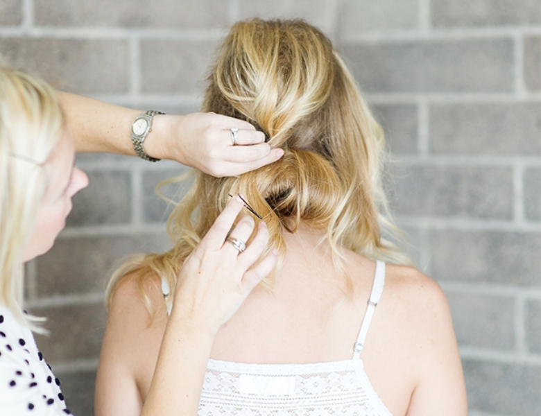 Picture Of romantic and easy diy low bun with crisscross  6