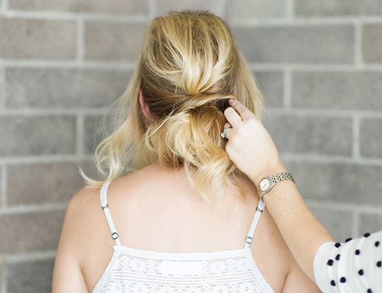 Picture Of romantic and easy diy low bun with crisscross  7
