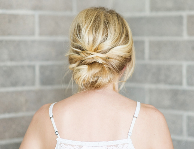 Picture Of romantic and easy diy low bun with crisscross  9