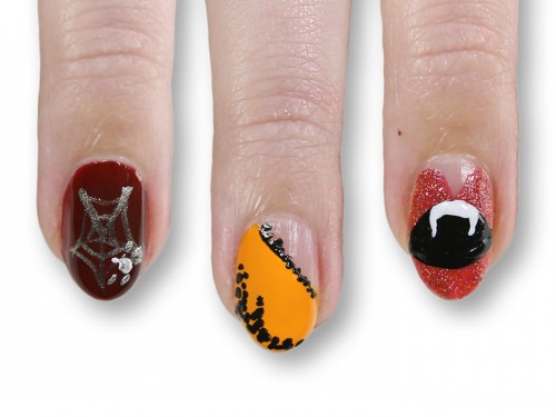Halloween nail art (via hellogiggles)