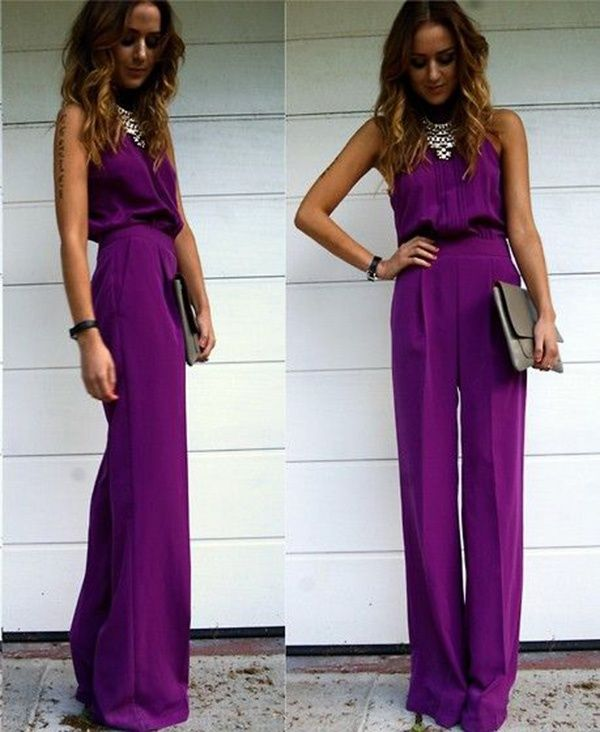 a bold fuchsia jumpsuit with a halter neckline, a statement necklace and a metallic clutch