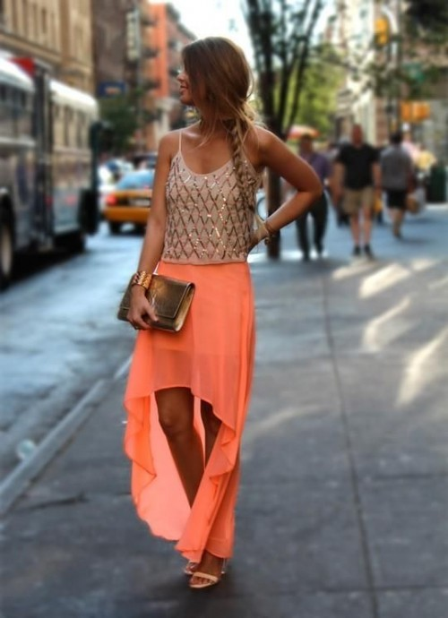 an embellished spaghetti strap top, a coral asymmetric maxi skirt, nude shoes and a metallic clutch