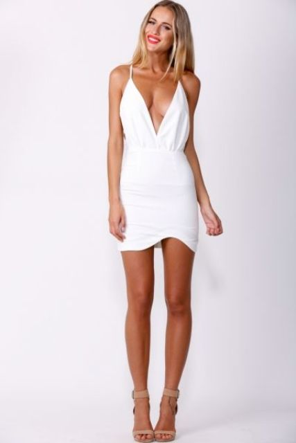 a white mini dress with a deep neckline and nude shoes is a sexy look for a summer look