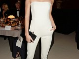 a white strapless fitting jumpsuit, black sheer shoes and a small black clutch for a monochromatic look