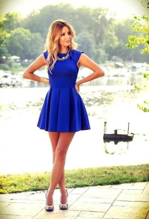 a bold blue A-line mini dress with cap sleeves, catchy shoes and a statement necklace
