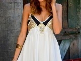 an A-line white, black and gold sequin mini dress with spaghetti straps is a cool piece for any party