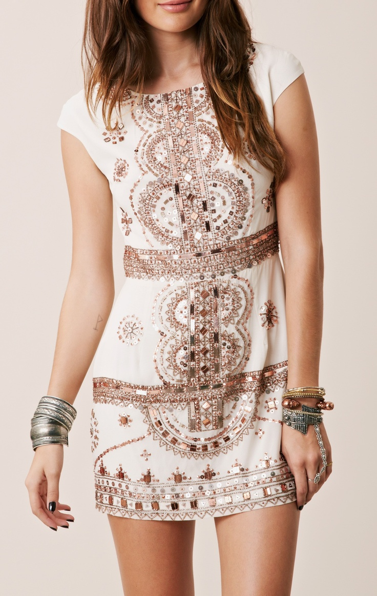 a white cap sleeve mini dress with copper beads and embroidery is a nice idea for a boho party
