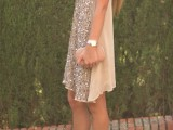 a tan mini dress with a fully embellished front, a bluch clutch and bluch heels for a bold party look