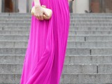 a strapless draped hot pink maxi dress, statement accessories and a metallic clutch