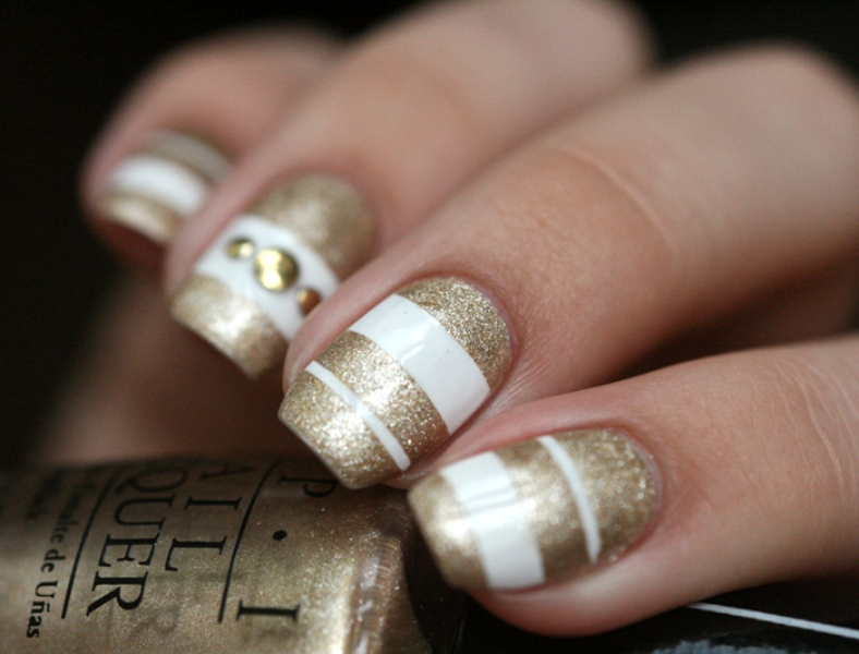 Picture Of sophisticated diy white and gold stripes manicure  2