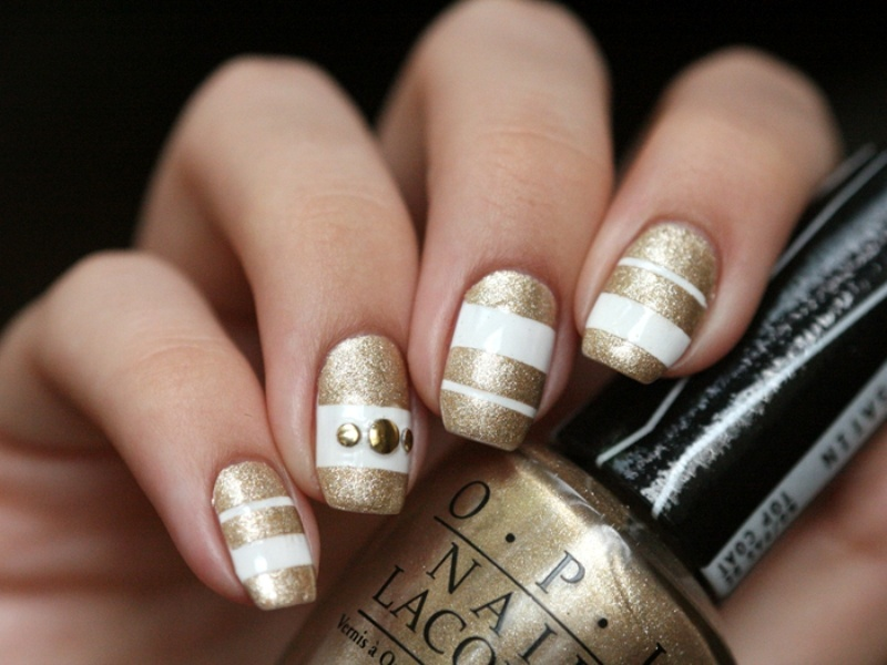 Picture Of sophisticated diy white and gold stripes manicure  3